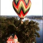 hot air balloon over house