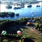hot air ballons over water