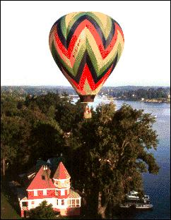 hot air balloon over house
